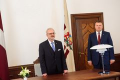 Egils Levits, Newly Elected President of Latvia and Raimonds Vejonis, Former President of Latvia, during Introduction ceremony in. RIGA, LATVIA. 8th of July 2019 stock photos