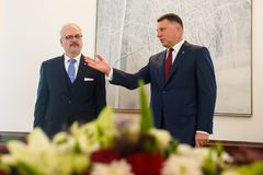 Egils Levits, Newly Elected President of Latvia and Raimonds Vejonis, Former President of Latvia, during Introduction ceremony in. RIGA, LATVIA. 8th of July 2019 stock images