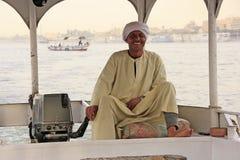 Egipski kapitan jedzie jego łódź na Nil rzece, Luxor Obraz Royalty Free