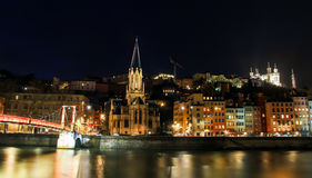 Eglise Saint Georges by night, Lyon old town, France. Panoramic view of Lyon old town and the river Saone at the night Stock Images