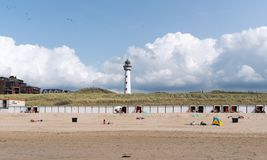 Egmond. Beach at Egmond an Zee, Netherlands. In the background a lighthouse stock photography