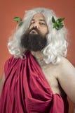 Egocentric God. Egocentric zeus god or jupiter against orange background stock photos