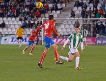 Egoitz Jaio r (18) в действии во время лиги Cordoba спички (w) против Numancia (r) Стоковое Фото