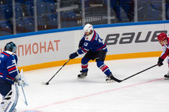 Egor Bashkatov (12) attack. RUSSIA, MOSCOW - APRIL 27, 2015: Egor Bashkatov (12) attack on hockey game CSKA vs SKA teams on Hockey Cup of Legends in Ice Palace Stock Images