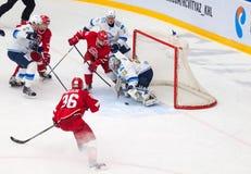 Egor Voronkov (59) attack Alexey Ivanov (28). MOSCOW - OCTOBER 17, 2015: Egor Voronkov (59) attack Alexey Ivanov (28) during hockey game Vityaz vs Barys on Royalty Free Stock Photo