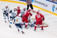 Egor Voronkov (59) vs Alexey Ivanov (28). MOSCOW - OCTOBER 17, 2015: Egor Voronkov (59) vs Alexey Ivanov (28) during hockey game Vityaz vs Barys on Russia KHL Stock Photography
