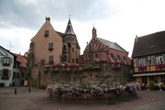 Eguisheim place. Church and fountain at Eguisheim alsace Royalty Free Stock Image