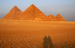 Egypt. Shadows of a couple of tourists near the pyramids, Cairo, Egypt Stock Image