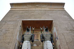 Egypt arch and guards. Two guards in front of an egytian arch royalty free stock photos
