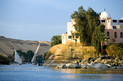 Egypt. Aswan, feluccas sailing on the Nile river in the town outskirts royalty free stock photos