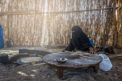 Egypt, Bedouin Village, August 28, 2017: Muslim woman, sitting b stock photos