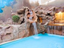 Pool with rocks fountain Royalty Free Stock Photography