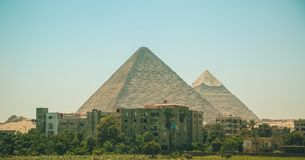 Egypt, Cairo; August 19, 2014 - the Egyptian pyramids in Cairo. The arch of the temple. Egypt, Cairo, the Egyptian pyramids in Cairo. Taureg  on a camel Royalty Free Stock Photography
