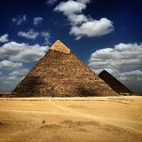 Egypt Cairo pyramids. Egypt pyramids into the clouds Stock Images