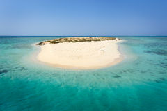 Egypt or Carribbean. In the picture an atoll with fine white sand, turquoise sea and surrounded by green situated in the Red Sea in Egypt, situated between the Stock Photography