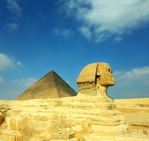 Egypt Cheops pyramid and sphinx. Famous ancient egypt Cheops pyramid and sphinx in Giza Stock Photo