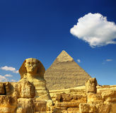 Egypt Cheops pyramid and sphinx. Famous ancient egypt Cheops pyramid and sphinx in Giza Royalty Free Stock Photos