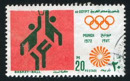 Olympic emblem. EGYPT - CIRCA 1972: stamp printed by Egypt, shows Basketball, Olympic emblem, circa 1972 Stock Image