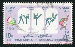 Olympic emblem. EGYPT - CIRCA 1991: stamp printed by Egypt, shows Mascot, Olympic emblem, circa 1991 Royalty Free Stock Images