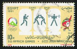 Olympic emblem. EGYPT - CIRCA 1991: stamp printed by Egypt, shows Mascot, Olympic emblem, circa 1991 Royalty Free Stock Photos