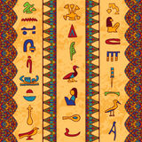Egypt colorful ornament with ancient Egyptian hieroglyphs and floral geometric ornament border on aged paper background. Royalty Free Stock Images