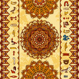 Egypt colorful ornament with ancient Egyptian hieroglyphs and ornate mandala with geometric ornament on aged paper background. Royalty Free Stock Image