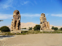 Egypt, The Colossi of Memnon. Egypt,The Colossi of Memnon, are two massive stone statues of the Pharaoh Amenhotep III, who reigned in Egypt during Dynasty XVIII Royalty Free Stock Images