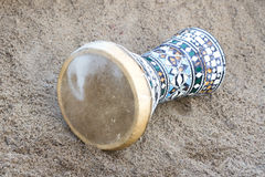 Egypt drum lying on the sand. Royalty Free Stock Photo