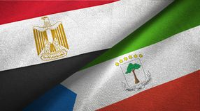 Egypt and Equatorial Guinea two flags textile cloth, fabric texture. Egypt and Equatorial Guinea two folded flags together vector illustration