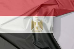 Egypt fabric flag crepe and crease with white space. Egypt fabric flag crepe and crease with white space, red white black color with the Egyptian eagle of stock photos