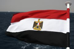 Egypt flag. On the wind by red sea royalty free stock photo