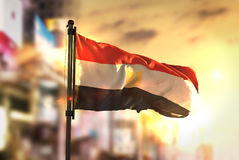 Egypt Flag Against City Blurred Background At Sunrise Backlight. Sky Royalty Free Stock Photography