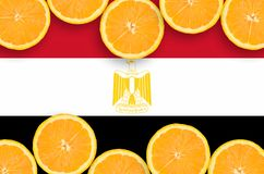 Egypt flag in citrus fruit slices horizontal frame. Egypt flag in horizontal frame of orange citrus fruit slices. Concept of growing as well as import and export stock illustration