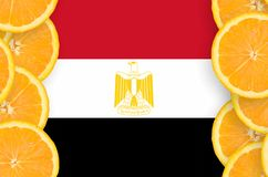 Egypt flag in citrus fruit slices vertical frame. Egypt flag in vertical frame of orange citrus fruit slices. Concept of growing as well as import and export of stock illustration