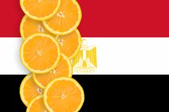 Egypt flag and citrus fruit slices vertical row. Egypt flag and vertical row of orange citrus fruit slices. Concept of growing as well as import and export of stock image