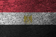 Egypt flag is depicted on the screen with the program code. The concept of modern technology and site development.  stock illustration