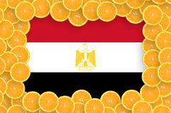 Egypt flag in fresh citrus fruit slices frame. Egypt flag in frame of orange citrus fruit slices. Concept of growing as well as import and export of citrus royalty free stock image