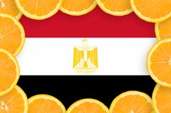 Egypt flag in fresh citrus fruit slices frame. Egypt flag in frame of orange citrus fruit slices. Concept of growing as well as import and export of citrus stock photos