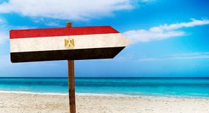 Egypt flag on wooden table sign on beach background. It is summer sign of Egypt. Egypt flag on wooden table sign on beach background. There is beach and clear vector illustration