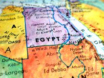 Egypt focus macro shot on globe map for travel blogs, social media, website banners and backgrounds. Egypt focus macro shot on globe map for travel blogs royalty free stock photos
