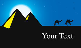 Egypt Great Pyramids with Camel caravan at night Royalty Free Stock Photo