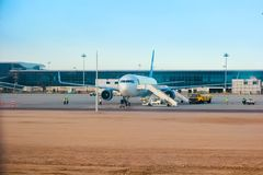 18.04.2014. Egypt, Hurghada. Airport of Hurghada. The plane expects landing of passengers, ladders are released. There is a. Loading of baggage before flight stock photo