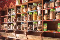 EGYPT, HURGHADA - 01 Avril 2019:Shelf of jars with various spices stock photo