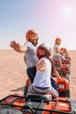 Egypt / Hurghada - 01/05/2016: A group of happy people ride quad bikes in the desert royalty free stock photos