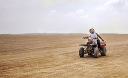 Egypt, Hurghada, January 2019 - quad safari through the desert of Egypt. Speed and movement. Two people royalty free stock photography