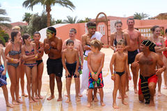 EGYPT, HURGHADA, MARCH 31, 2015: Animation team perform Olympic. Games water polo in egyptian water park hotel beach resort, March 31, 2015 royalty free stock photos