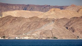 Egypt and Israel Border Fence. Coastline landscape of the boarder between Egypt and Israel on the Red Sea in the Gulf of Aqaba. The fence is the boarderline royalty free stock images