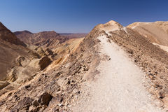 Egypt Israel boundary fencing in stone desert mountains trail. Royalty Free Stock Image