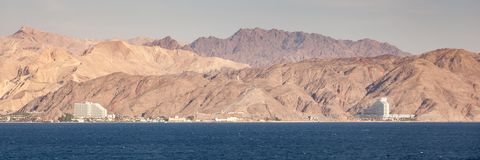 Egypt and Israel Coastal Landscape. Coastline landscape of the boarder between Egypt and Israel on the Red Sea in the Gulf of Aqaba. The fence is the boarderline stock photos