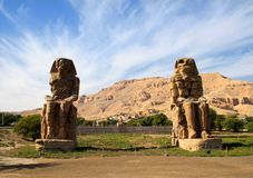 Egypt. Luxor. The Colossi of Memnon - two massive stone statues. Egypt. Luxor Two huge stone statues called Colossi of Memnon Pharaoh Amenhotep III royalty free stock photography